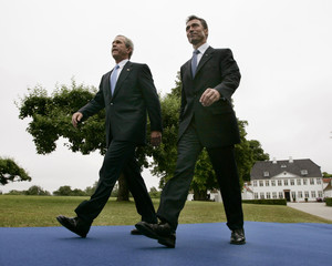 US President Bush and Danish PM Rasmussen walk to joint conference, Denmark.