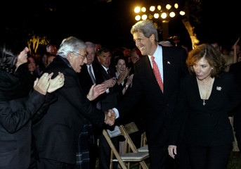 JOHN KERRY AND WIFE TERESA GREETED AT BEVERLY HILLS FUNDRAISER.