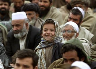 AN AFGHAN BOY SMILES DURING PEOPLE'S MEETING IN KALAKAN.