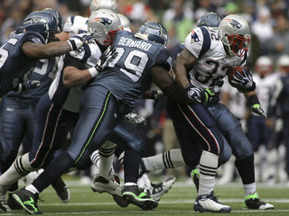 Patriots Jordan is tackled by the Seattle Seahawks defense during the third quarter of their NFL football game in Seattle