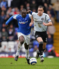 Birmingham City's Heskey challenges Chelsea's Terry during their soccer match at St Andrews in Birmingham