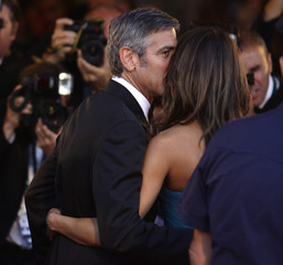 Actor Clooney kisses his girlfriend Canalis as they pose for photographers during a red carpet at the 66th Venice Film Festival