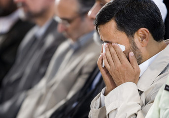 Iranian President Mahmoud Ahmadinejad cries as he listen to speech by daughter of member of Iranian police who died during conflict with drug smugglers during ceremony to mark UNs' International Day against Drug in Tehran