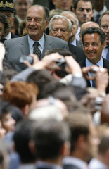 France's incumbent President Chirac and newly-elected President Sarkozy attend a ceremony to pay tribute to the abolition of slavery in Paris