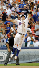 New York Mets third baseman Wright leaps to snare a line drive by Colorado Rockies batter Atkins for the final out as the Mets won their MLB National League baseball game in New York