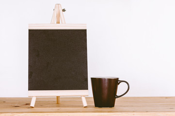 Wooden menu board with coffee on wooden table