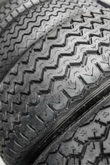 Row of black car (vintage) tyres.