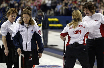 Nova Scotia walk off ice as Team Canada celebrate at Scott Tournament of Hearts in London, Ontario