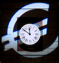 EURO SYMBOL IS PROJECTED OTON CLOCK OF MADRID'S CENTRAL PUERTA DEL SOL.