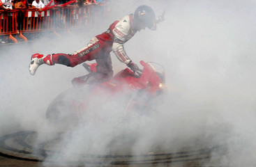 Spanish rider Zamora smokes his tyres during an acrobatic show in Adra