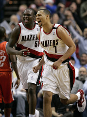 Trail Blazers' Roy and Randolph react after Roy scored against the Bobcats in Portland