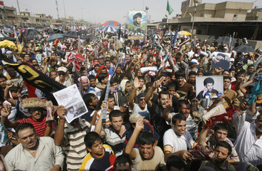Demonstrators chant slogans during a protest in Baghdad's Sadr City