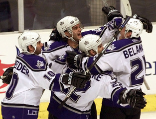 KINGS LUC ROBITAILLE CELEBRATES GOAL AGAINST RED WINGS.