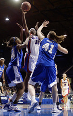 DePaul University guard Towers shoots between University of Tulsa's Moody and Robbins in Rosemont