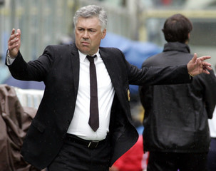 AC Milan coach Ancelotti gestures during the season-ending Italian Serie A soccer match against Fiorentina in Florence