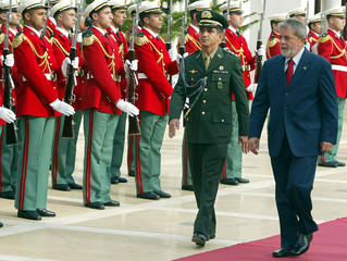 Brazilian President Luiz Inacio Lula da Silva reviews troops upon his arrival at the  presidential palace in Algiers