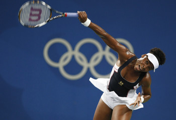 Venus Williams of the U.S. serves to Li Na of China during their quarterfinal tennis match at the Beijing 2008 Olympic Games
