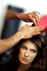 Model gets ready backstage before appearing in Pasarela Pontus Veteris fashion show in Pontevedra
