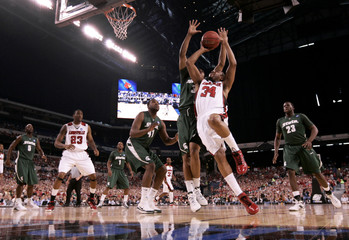 Louisville Cardinals Jerry Smith goes to the basket against Michigan State Spartans Chris Allen during the first half of their NCAA men's Midwest Regional finals basketball game in Indianapolis