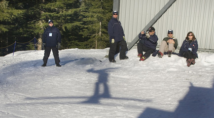Course workers watch competition during World Cup Ski Jumping in Whistler