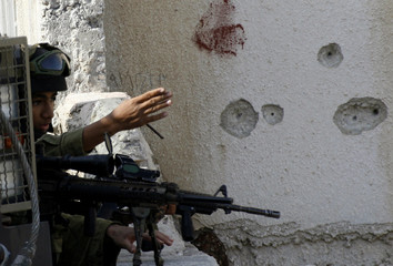 Israeli soldier takes position during military operation in Nablus