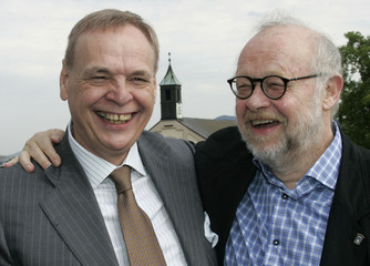 Salzburg Festival Artistic Director Flimm and his successor Pereira pose after a news conference in Salzburg