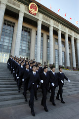 Plainclothes security officers patrol Great Hall of the People in Beijing