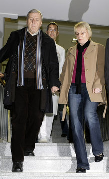 Mannichl and his wife come down the stairs before a statement in the hospital of Passau