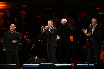 Singers Billy Joel, Sting, and James Taylor perform during the Rainforest Foundation Benefit Concert in New York