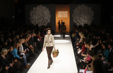 A model presents a creation from the Caroline Charles 2009 Autumn/Winter collection during London Fashion Week