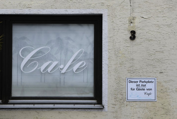 A window of the former cafe Traudel is pictured at the main street in Fuerstenzell