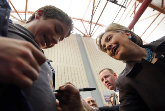 Democratic presidential candidate US Senator Hillary Clinton (D-NY) autographs a sticker on a boy's shirt at a campaign rally in Hartford