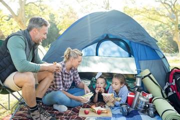Family having snacks outside the tent