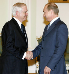 US Defence Secretary Gates greets Russia's President Putin in Moscow's Kremlin