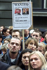 WORKERS OF BELGIUM'S FAILED AIRLINE SABENA HOLD A BANNER SHOWINGPICTURES OF FORMER SABENA MANAGERS ...
