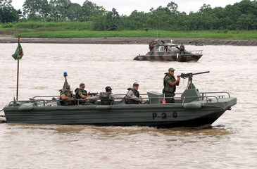 BRAZILIAN SOLDIERS PATROL ALONG THE SOLIMOES RIVER NEAR TABATINGA IN THE AMAZON.