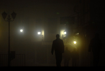 A man walks through heavy fog in the centre of the Macedonian capital of Skopje