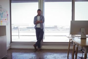 Portrait of male designer standing in office