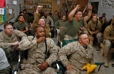 US Marines cheer as they watch the Super Bowl at Camp Hit in western Iraq