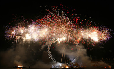 Fireworks explode over the River Thames in London to celebrate the new year