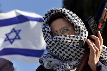 RIGHT WING ISRAELI WEARS ARAB KEFFIYAH AT DEMONSTRATION IN JERUSALEM.