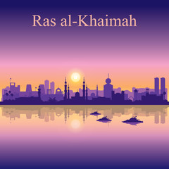 Ras al-Khaimah silhouette on sunset background