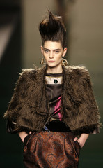 A model presents a creation by Victorio&Lucchino during the Pasarela Cibeles Autumn/Winter 09-10 fashion week in Madrid