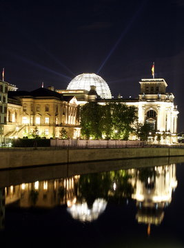 Streams of light beam from the cupola of the Reichstags building, the seat of the German lower house..