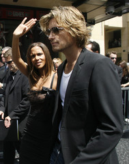 Academy Award winning actress Halle Berry waves to fans, as her boyfriend Gabriel Aubry and her leave after ceremonies to unveil her star on the Hollywood Walk of Fame in Hollywood