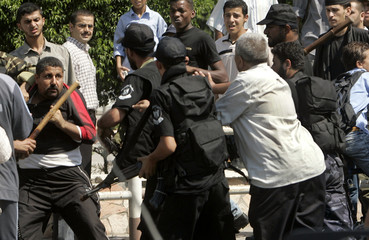Palestinian security forces, controlled by Hamas-led government, clash with Palestinians in Gaza