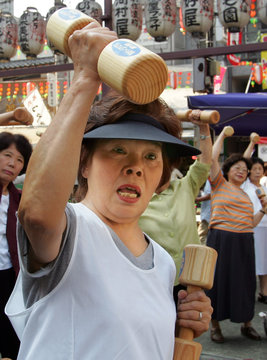 """Middle-aged women exercise using weights during a event to mark Japan's """"Respect for the Aged Day"""" in ..."""