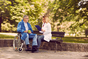Checking up the history of the disease senior patient in wheelchair.