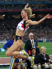 HEIKE DRECHSLER OF GERMANY FLIES THROUGH THE AIR ON HER WAY TO A GOLD MEDAL WIN IN THE WOMEN'S ...