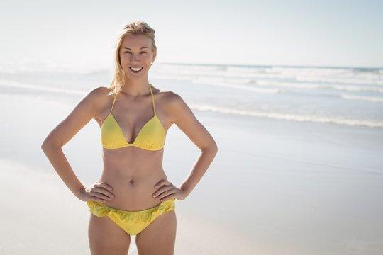 Portrait of smiling young woman in yellow bikini